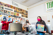 HSU students in a computer lab holding El Leñador magazine for the camera
