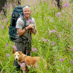 HSU alum hiking with his dog