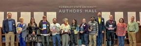 Line up of authors under the authors hall sign in the library