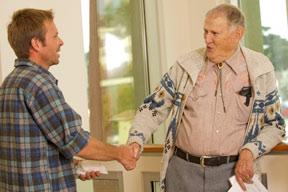 Wildlife student shaking hands with Professor Emeritus Stanley Harris