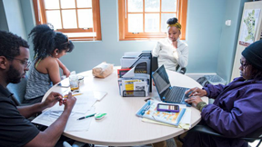 Student sitting around a table at the AACAE study room