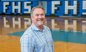 Dan Phillips standing in a gymnasium
