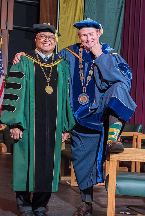 CSU Chancellor White shows off his Humboldt socks.